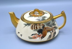 A 19th Century Japanese Satsuma Teapot with hand painted and gilded decoration depicting a bird of