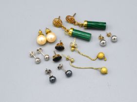 A Pair of Malachite set drop ear studs together with six other pairs of ear studs