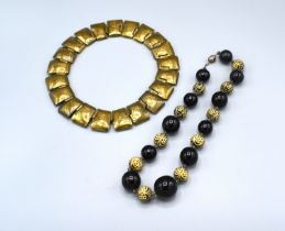 An unusual metal linked necklace with hammered decoration together with A Turquoise Bead Necklace