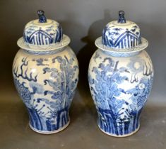 A Pair of Chinese Large Underglaze Blue Decorated Covered Vases, the covers with dogs of fo