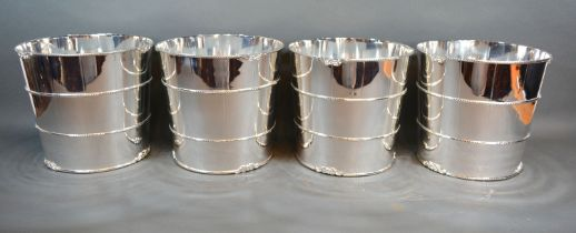A set of four silver plated wine coolers, each in the form of a barrel, 21cms diameter, 19.5cms high
