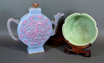 A Chinese Celadon Bowl of shaped outline with hardwood stand 14 cms diameter together with a Chinese