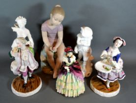 A Nao Figure in the form of a girl sitting on a rock, 30 cms tall together with a Royal Doulton