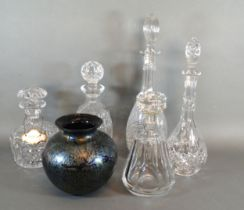 A Baccarat Glass Decanter with stopper together with four other similar decanters and an Isle of