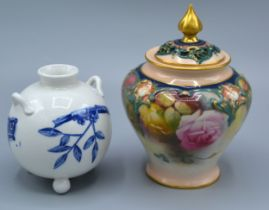 A Royal Worcester Bulbous Shaped Squat Vase decorated in blue and white in the Oriental style