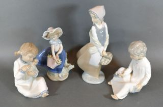 A Lladro Porcelain Figure in the form of a Girl With A Basket Of Flowers 17.5 cms tall together with