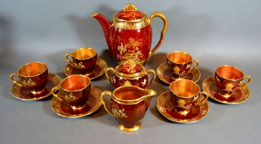 A Carlton Ware Rouge Royale Coffee Service comprising coffee pot, cream jug, covered sucrier and six