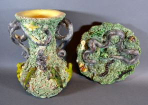 A Portuguese Palissy Two Handled Vase decorated in relief with frogs and lizards, the handles in the