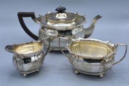A Late Victorian Silver Three Piece Tea Service comprising teapot, two handled sucrier and cream jug