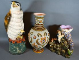 A Mettlach Vase, 31cms tall, together with a Melba Ware model of an eagle and a continental group
