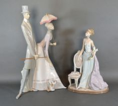 A Lladro Porcelain Model in the form of a Girl Standing By A Chair Holding Flowers, 37 cms tall