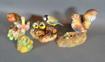 A Royal Crown Derby Porcelain Group Blue Tit and Chicks together with another Robin, another