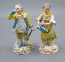 A Pair of Berlin Porcelain Figures each decorated in polychrome enamels and highlighted with gilt 14