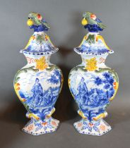 A Pair of Delft Covered Vases each with bird surmount decorated in underglaze blue and polychrome