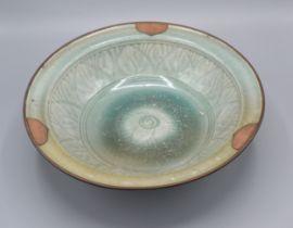A Chinese Celadon Bowl with metal rim 28 cms diameter