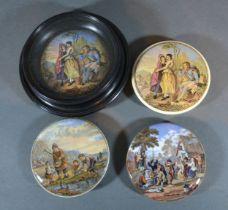 A Pratt Ware Pot Lid 'The Village Wedding' together with three other similar Pratt Ware pot lids