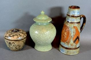 A Chinese Celadon Covered Vase of Oviform, together with a stone ware jug vase and a stone ware