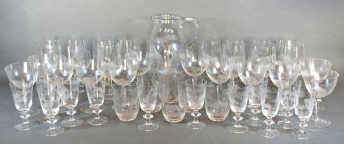 A Moser Rowland Ward Safari Pattern Cut Glass Drinking Set comprising a large jug, wine glasses,