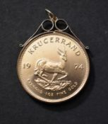 Gold South Africa Krugerrand 1974, approx 34.00 Grams of Gold, it has a Gold Mount for a Necklace an