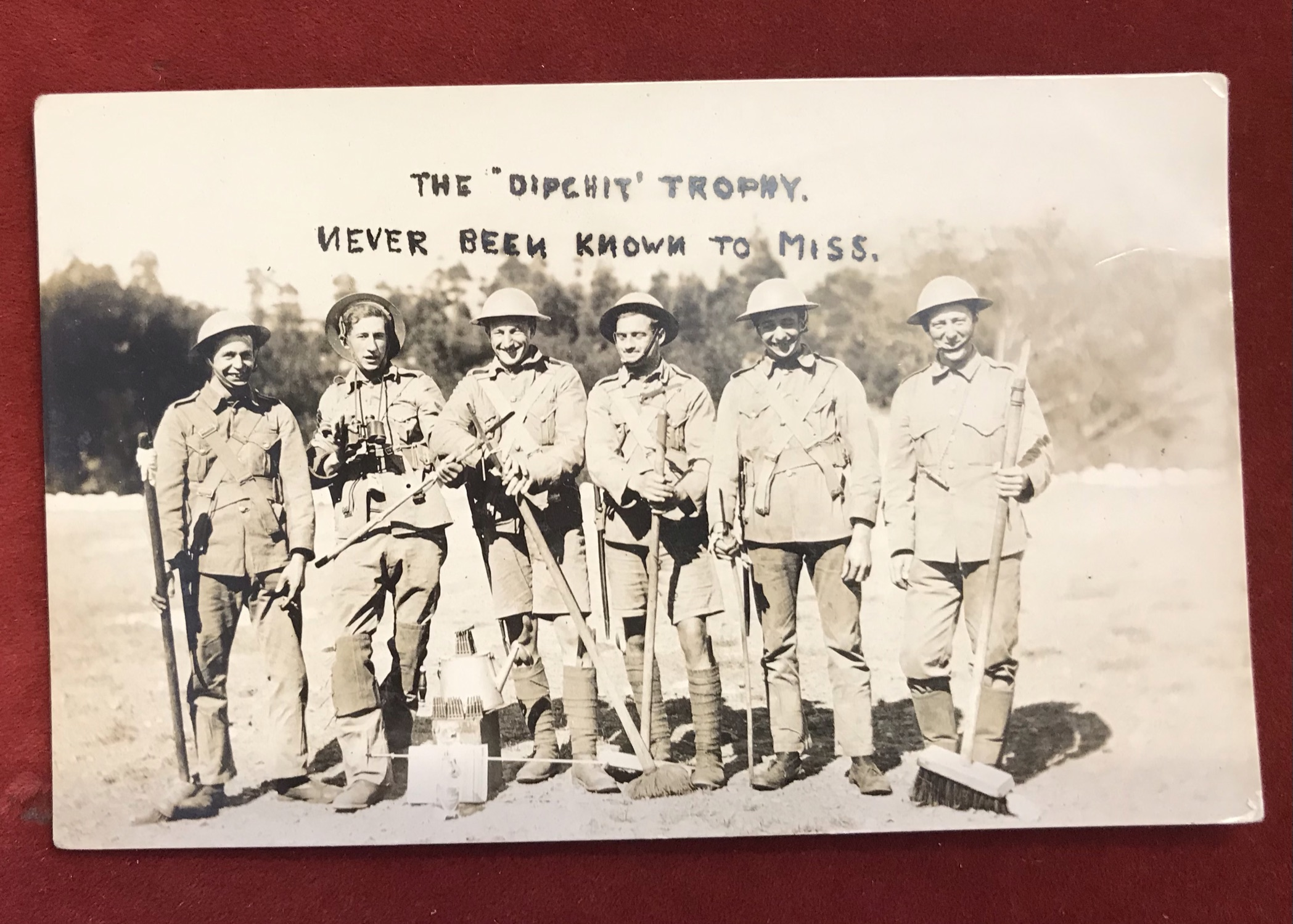 """British inter-war RP Postcard """"The 'Dipchit' Trophy. Never been known to miss."""" showing a group of"""