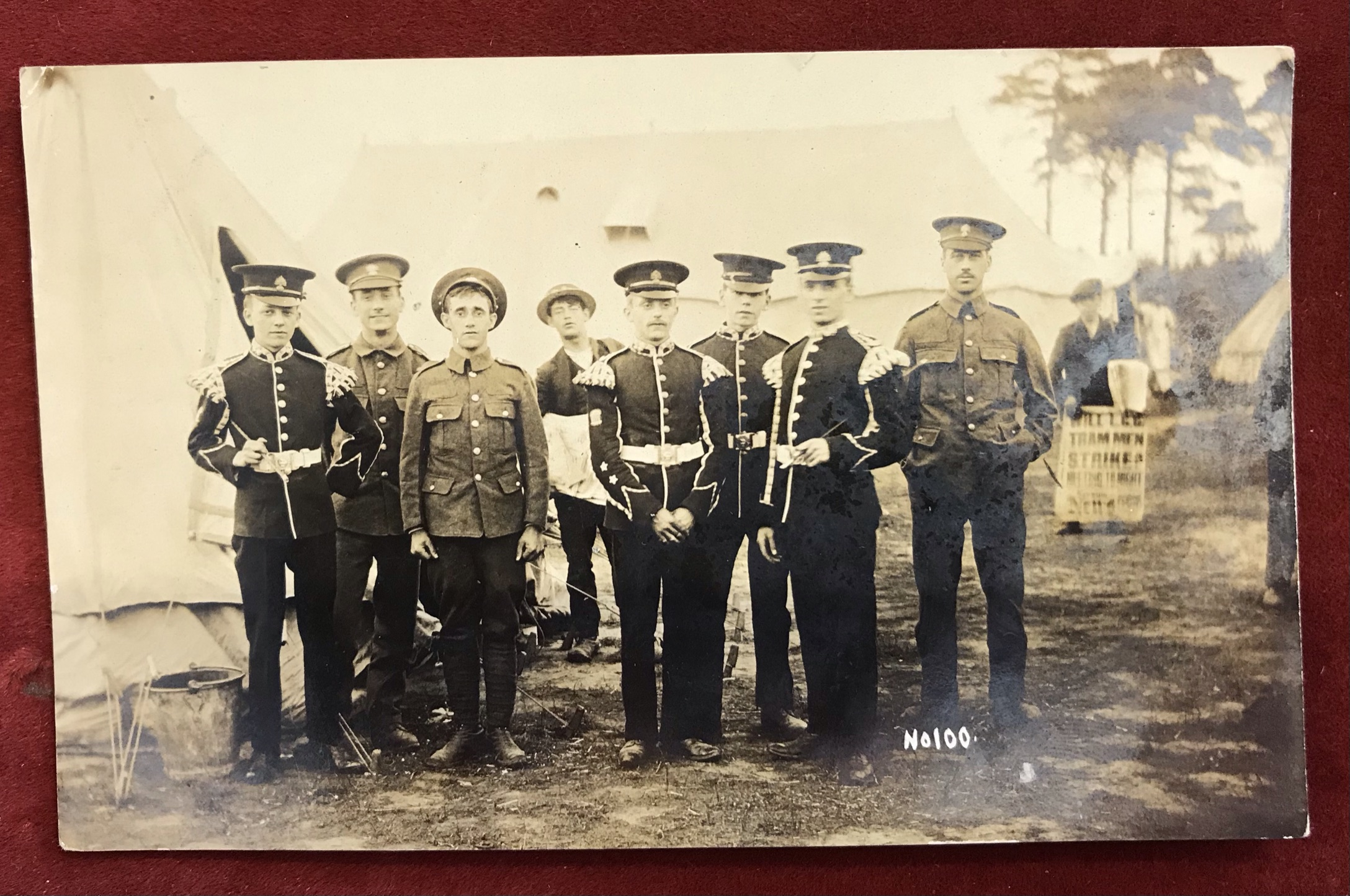 Royal Fusiliers Bandmen RP Card showing the men in camp, News bulletin in the background Will L.G.G,