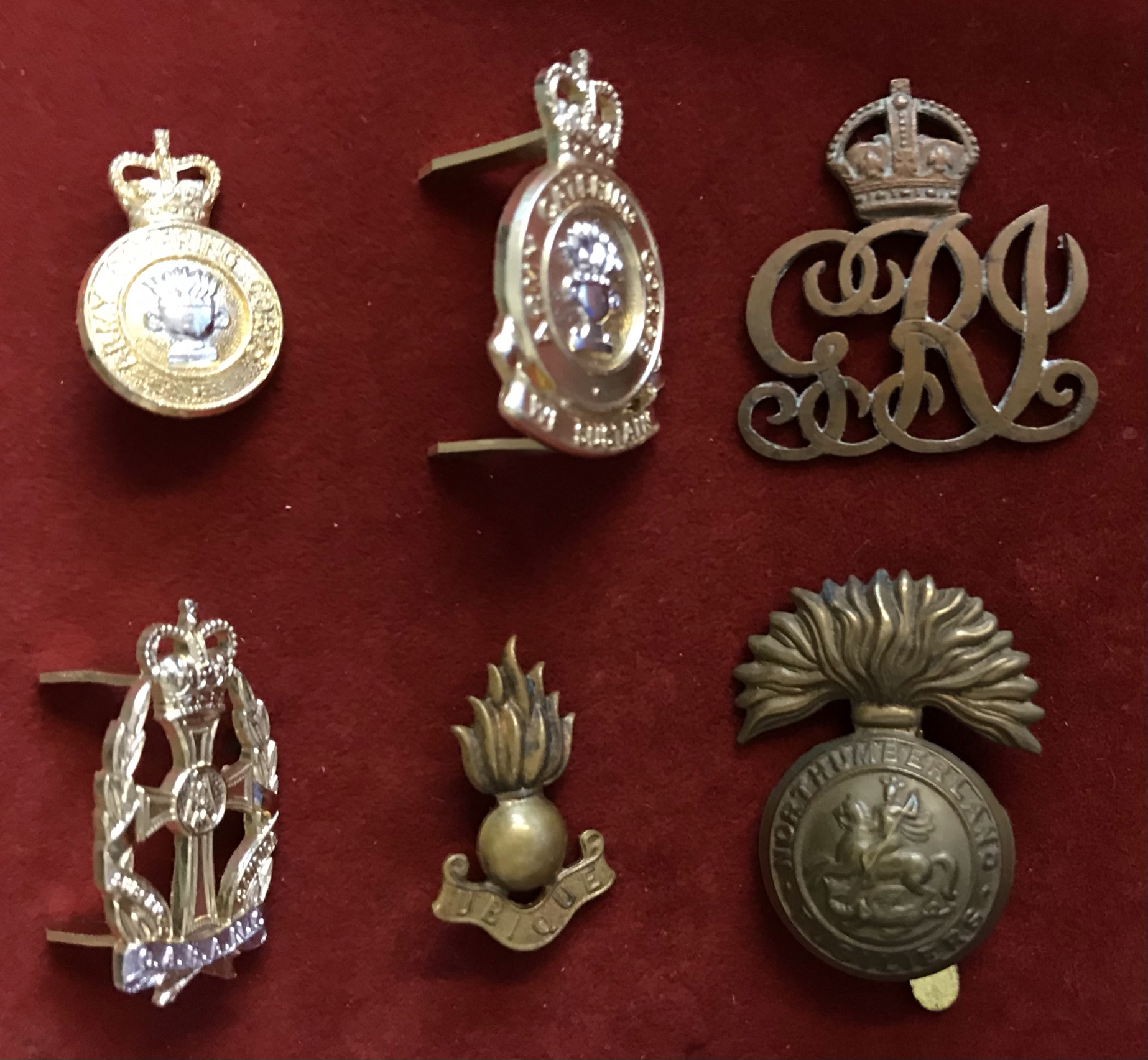 British Cap Badges (6) Including: Army Catering Corps (Staybright), Northumberland Fusiliers',