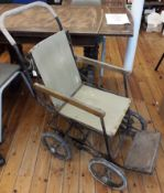 British WWI/II Allwin standard No.2 foldable wheelchair, a sturdy chair with a fabric seat