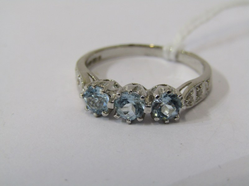 9ct WHITE GOLD TOPAZ & DIAMOND RING, 3 principal well matched blue topaz stones with accent diamonds