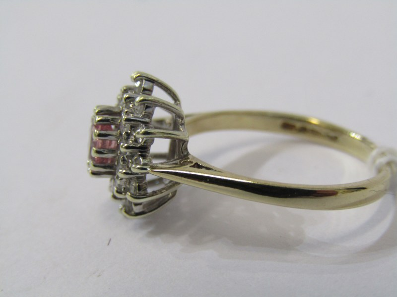 9ct YELLOW GOLD PINK SAPPHIRE & DIAMOND CLUSTER RING, principal oval cut pink sapphire surrounded by - Image 2 of 3