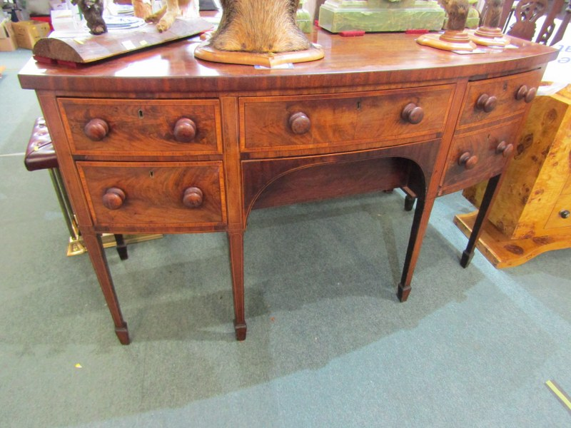 LATE GEORGIAN CROSS BANDED MAHOGANY BOW FRONT KNEEHOLE SIDEBOARD, of 4 drawers with wooden knop
