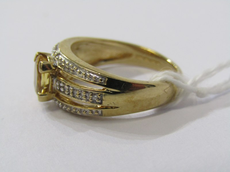 9CT YELLOW GOLD CITRINE & DIAMOND RING, principal oval cut citrine in 4 claw setting, set with - Image 2 of 3
