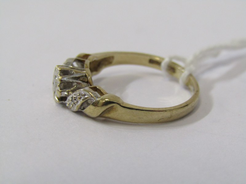9CT YELLOW GOLD DAIMOND SOLITAIRE RING, principal illusion set diamond with accent diamonds to - Image 2 of 3
