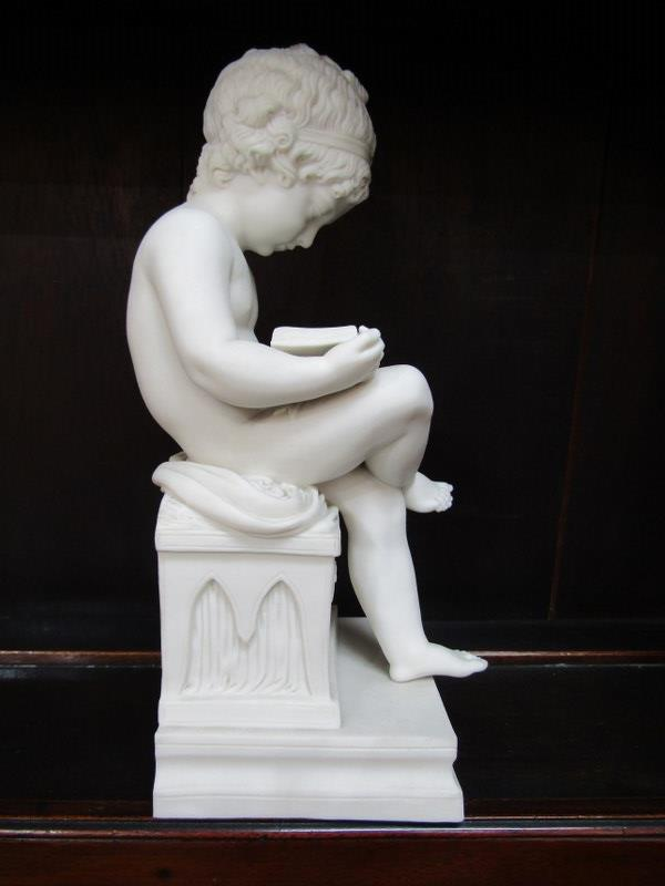 "PARIAN FIGURE, seated Boy reading book, chip to square base, 11"" height - Image 3 of 5"