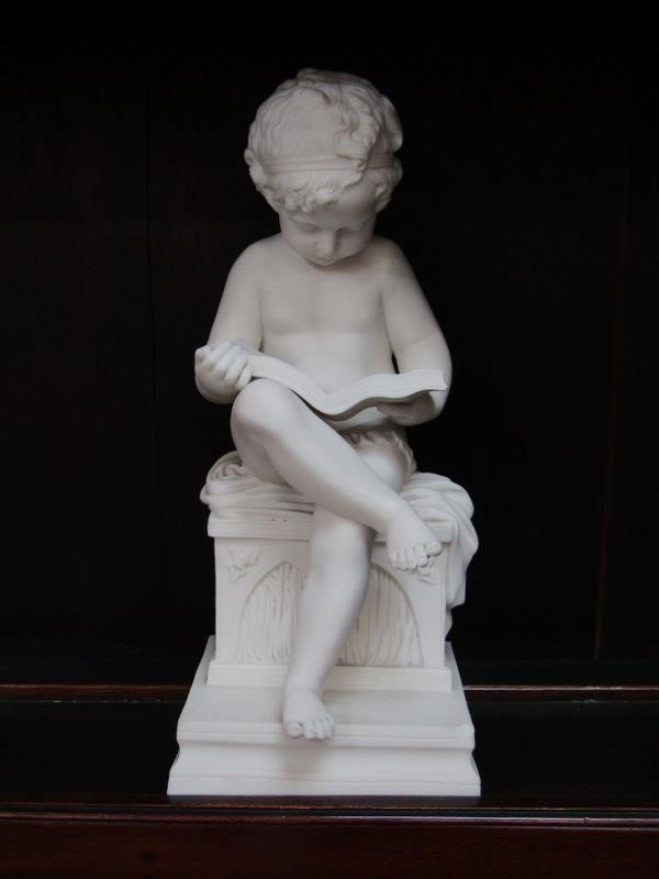 "PARIAN FIGURE, seated Boy reading book, chip to square base, 11"" height - Image 2 of 5"