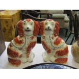 STAFFORDSHIRE POTTERY, pair of mid 19th Century Staffordshire seated Spaniels, terracotta colouring,