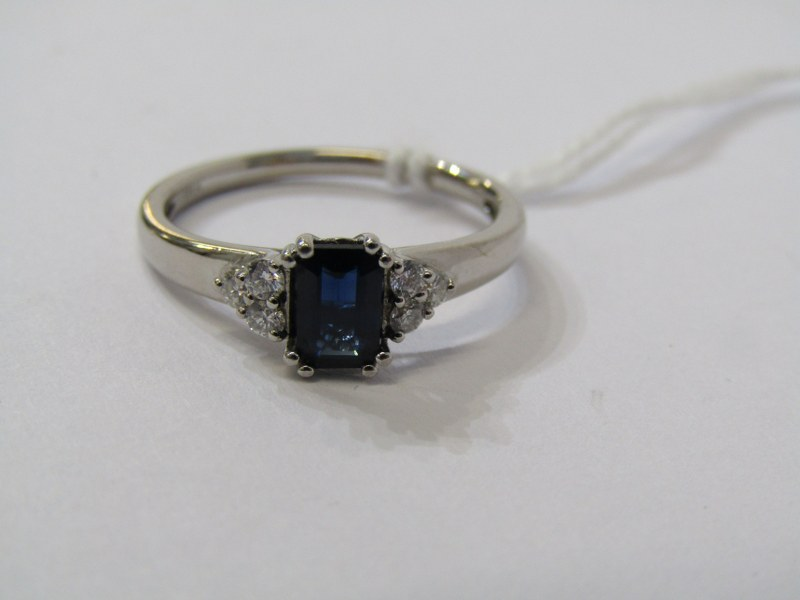 18ct WHITE GOLD, SAPPHIRE & DIAMOND RING, principal rectangular cut dark royal blue sapphire with