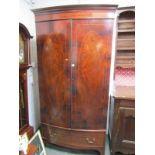 HEPPLEWHITE DESIGN BOWFRONTED TWIN DOOR WARDROBE, oval inlaid flambe mahogany doors with single