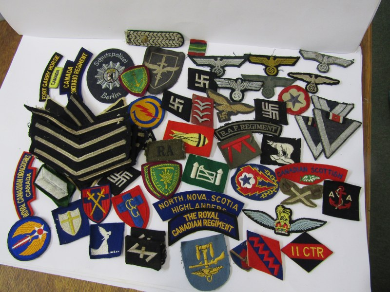 MILITARY, A collection of embroidered cloth military badges including several with Nazi emblems