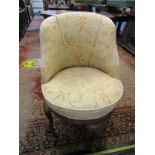 UPHOLSTERED TUB DESIGN DRESSING CHAIR with swivel circular base on cabriole legs