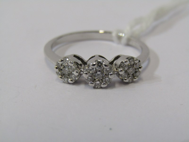 18ct WHITE GOLD TRIPLE CLUSTER RING, 3 illusion set diamond clusters, set to form a 3 stone ring,