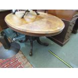 VICTORIAN BURR WALNUT MARQUETRY BREAKFAST TABLE, oval tilt top on 4 column support and carved scroll