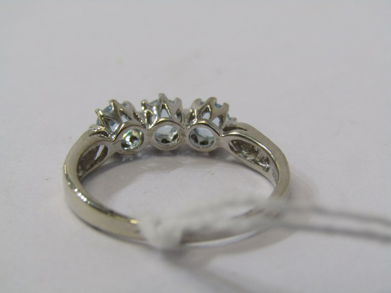 9ct WHITE GOLD TOPAZ & DIAMOND RING, 3 principal well matched blue topaz stones with accent diamonds - Image 3 of 3