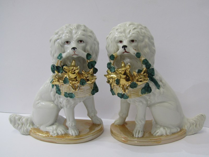 """PORCELAIN DOGS, pair of 19th Century seated dogs carrying baskets of gilded pigs, 8"""" height"""