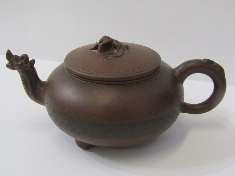 ORIENTAL CERAMICS, Chinese Yixing tea pot of compressed circular body with Cockshead spout and