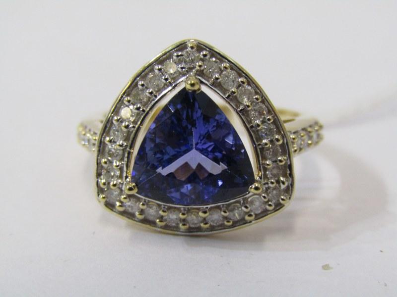 18ct YELLOW GOLD TANZANITE & DIAMOND RING, principal trillion cut tanzanite in excess of 2cts,