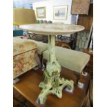 ORNATE POTTERY WINE TABLE, floral and foliate design base tripod wine table with floral painted dish