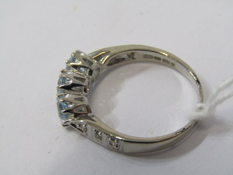 9ct WHITE GOLD TOPAZ & DIAMOND RING, 3 principal well matched blue topaz stones with accent diamonds - Image 2 of 3