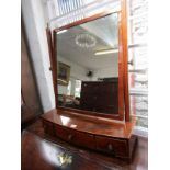 LATE GEORGIAN BOW FRONTED SWING DRESSING MIRROR, inlaid mahogany triple drawer base with rectangular