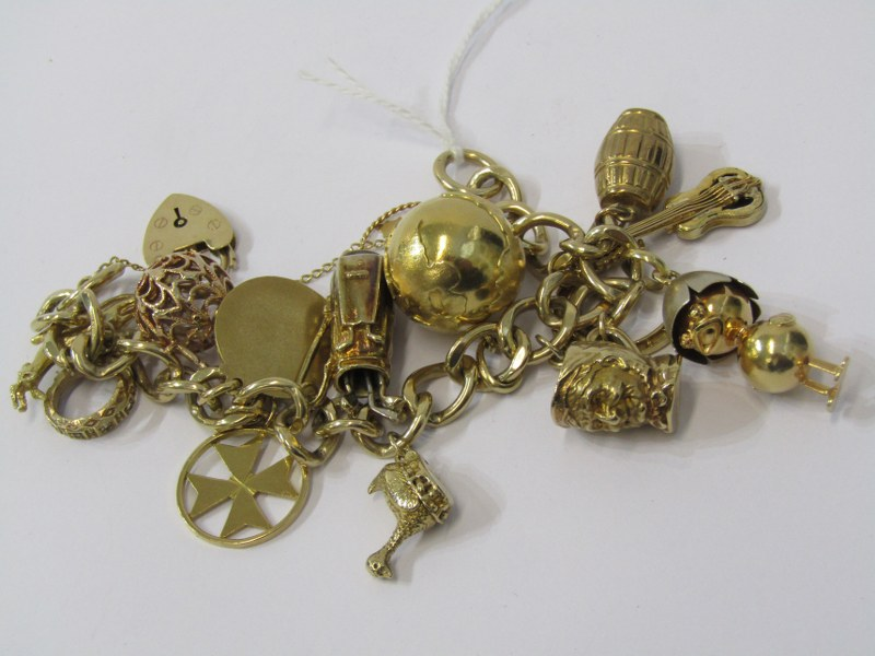 9ct YELLOW GOLD CHARM BRACELET, multi charms including globe, barrel, Maltese Cross, chick with