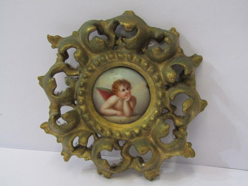 "19th CENTURY CIRCULAR PORCELAIN PLAQUE, ""Cherub"" in ornate carved gilt wood frame, 4.5"" dia"